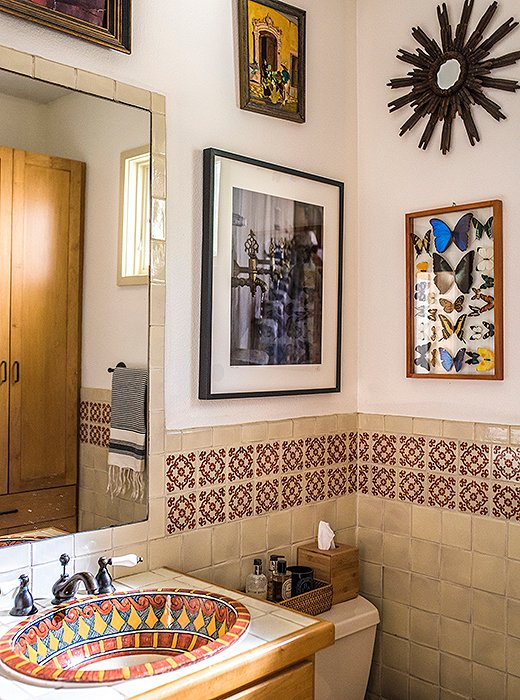 Bold tiles and bespoke fixtures are a surefire way to nail the boho look in the bathroom. Accessorize with eclectic art and texture-rich accents to finish the look. Photo by Shayna Fontana.