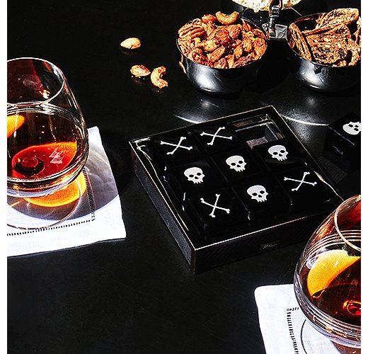 A luxe tic-tac-toe set helps while away the hours until midnight.