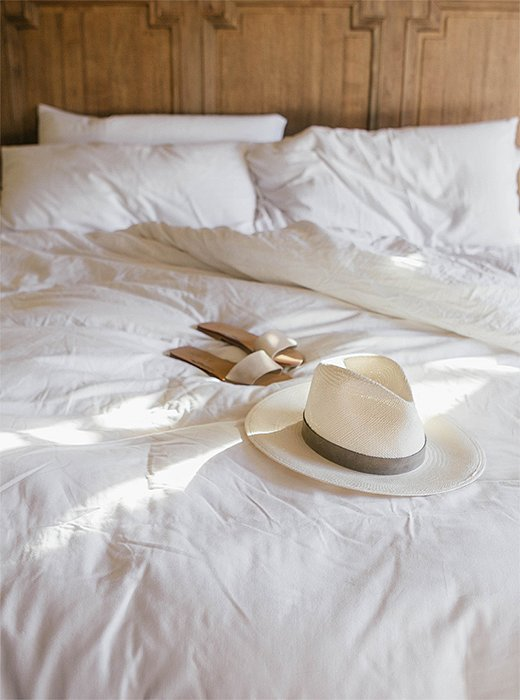 """I like to keep things simple when packing for wine country,"" says Ashley. ""Everyday basics, a dress or two, and my favorite accessory: a straw hat."" Photo by @ashleykane."