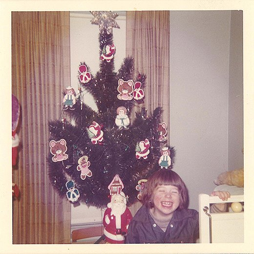 "Bob at age four with a Christmas tree decorated by his brother as a surprise. ""I have such a powerfully happy memory of coming home and finding that tree, and that same feeling of wonder still comes over me each year at the holidays,"" Bob writes."