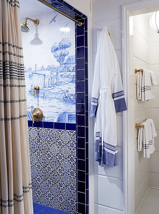 The custom nautical scenes on the bathroom tiles were hand-painted in Portugal and put together on-site like a puzzle.