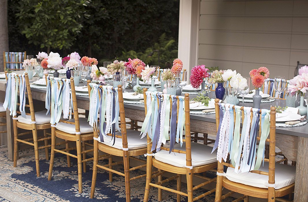 """I wanted to do something to dress the chairs up,"" says Susan. ""I saw a picture on Pinterest of a wedding where they used ribbons on the chair. It looked so pretty and felt like a really fun ode to summer and something that could be easily tailored to work for my color story."""