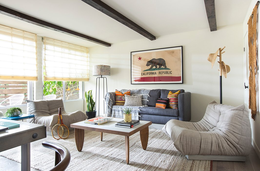 Wood beams lend architectural character to this bedroom's sitting area. Photo courtesy of The Goodland.