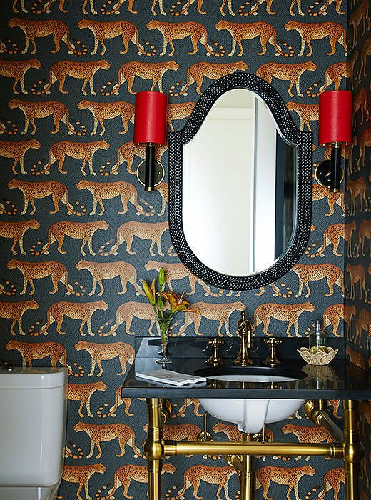 The powder room pops with yet another example of a timeless animal-inspired motif.