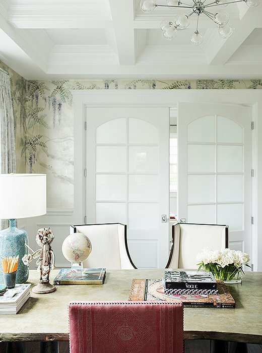 French doors that let in the lightwere chosen for the space, while the hand-painted de Gournay wallpaper was Rachel's 40th birthday gift to herself.