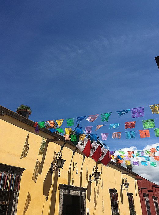 """Every single street in the city is cobblestoned and colorful,"" Jess says. These papel picado flags, Mexican folk-art decorations cut from tissue paper, caught her editor's eye."