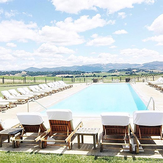 Edged with chaise longues, the Carneros pool looks out over hills traced by grapevines. Photo by @ashleykane.
