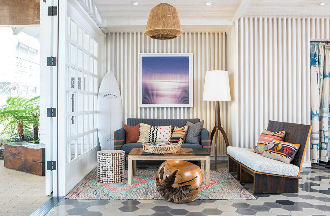 More surf references in a cozy corner of the lobby—plus a medley of tribal textiles and sculptural wood furnishings. Photo courtesy of The Goodland.