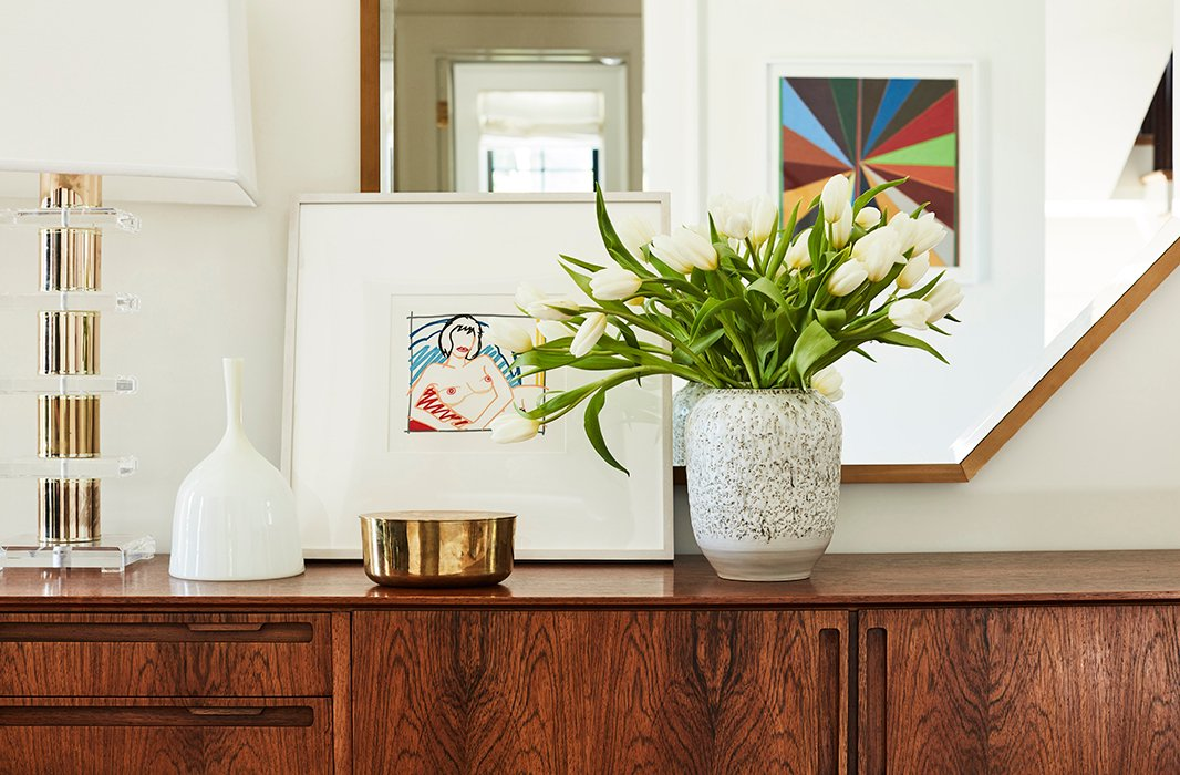 """Musts for an entryway are a credenza with storage, a superspecial lamp, a tray or bowl for keys, and a mirror to reflect the light that comes in through the front,"" Emily says."