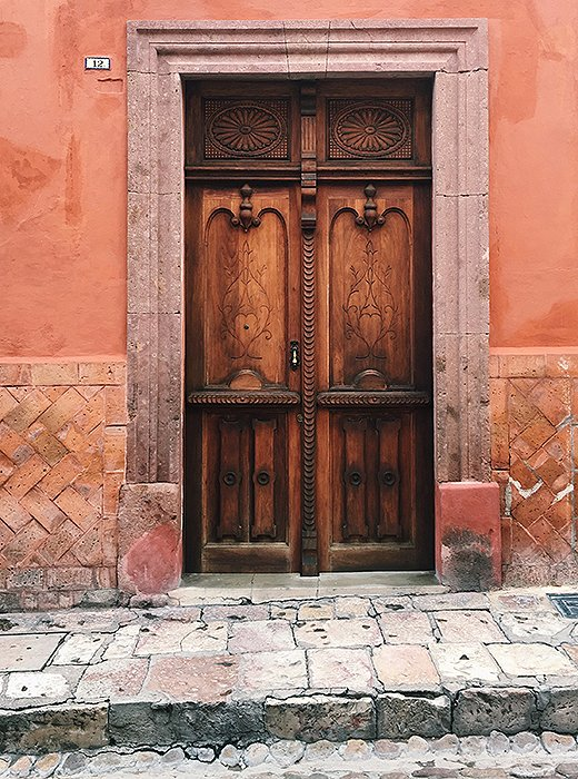 Set into stucco walls that line the city streets, the doors of San Miguel de Allende promise untold treasures behind their imposing facades. The larger doors were built to accommodate horse-drawn carriages.