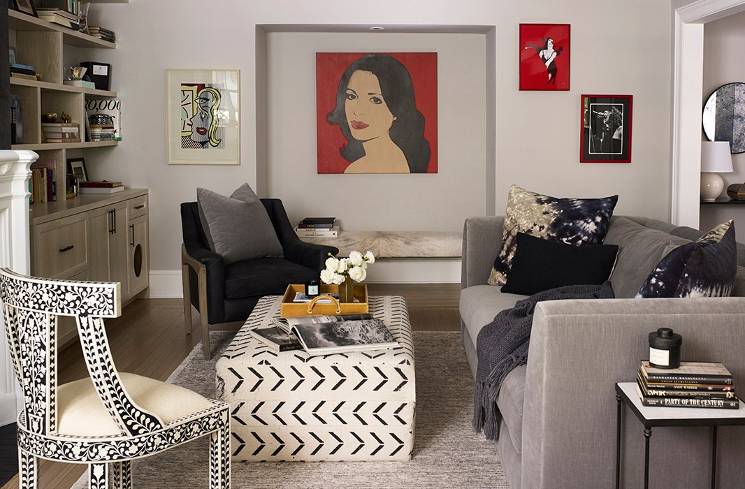 Artwork passed down from Suki's mother, including a Warhol portrait, pops perfectly against neutral walls. Underneath, a hide-and-acrylic bench serves as the perfect spot for guests to perch.