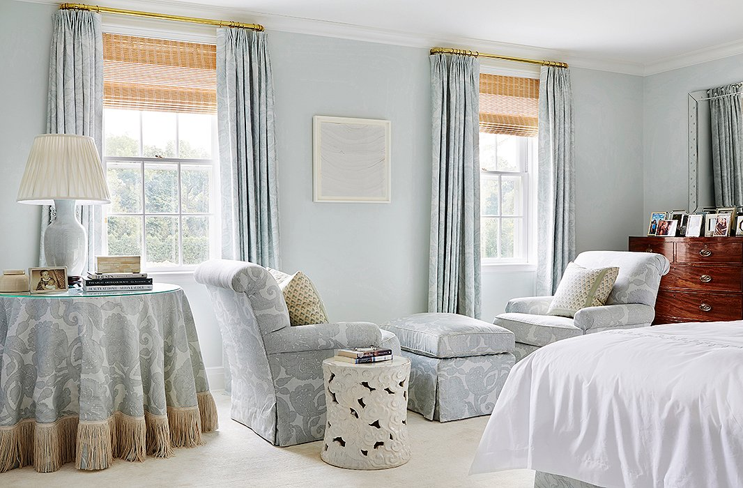 A pale blue hand-painted damask by Christopher Farr, a fabric the homeowner loved, became the presiding pattern story in the restful master bedroom.