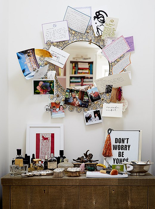 The vanity in the master bedroom is a place of memories: favorite perfume bottles, silver brushes from Amanda's grandmother, photos and notes from close friends, and a Beyoncé print from her daughter after they attended a concert together.