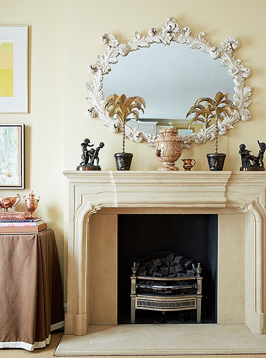 Elegant juxtapositions underlie Amanda's designs. Case in point: The living room's limestone mantel is topped with a favorite rococo white plaster mirror and her grandmother's cast-bronze figurines.