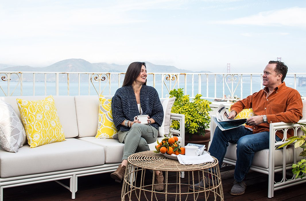 Out on the home's deck, a comfy seating area outfitted with Selamat furniture and pillows is backed with views of the Golden Gate Bridge and the Pacific.
