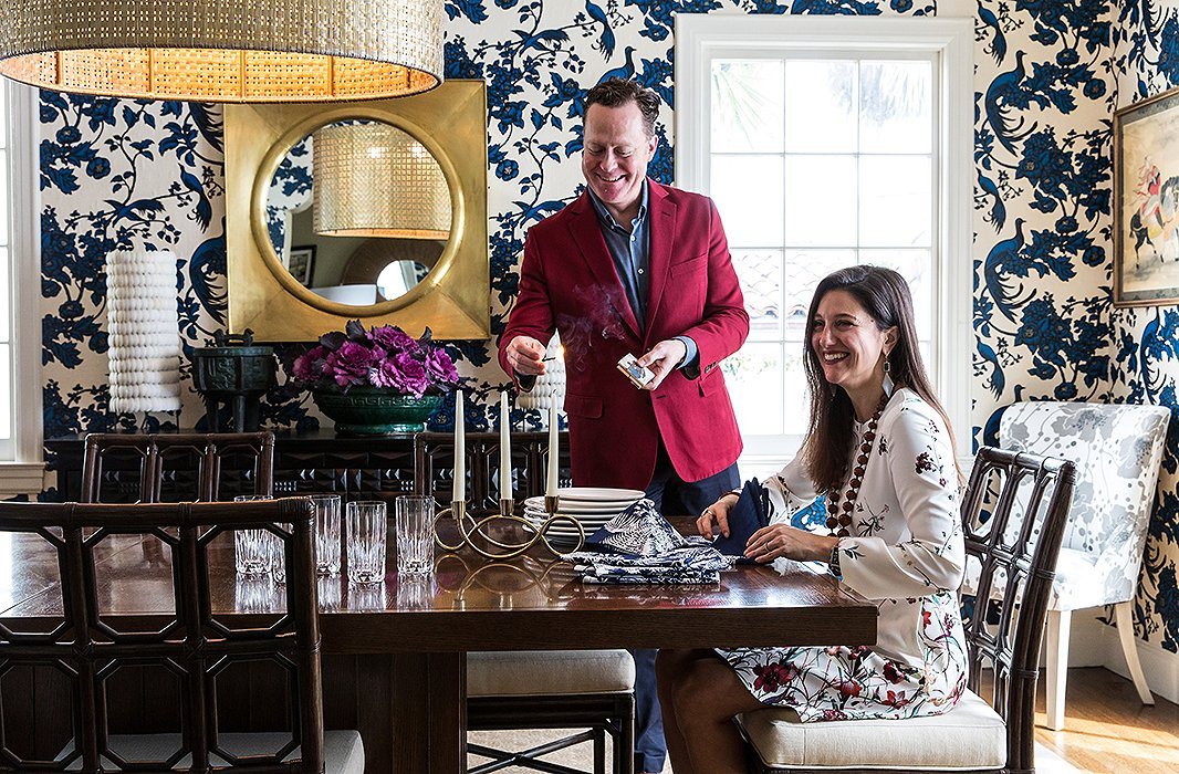 """The showstopping dining room is wallpapered in Broadhurst's signature Birds of Paradise print. """"There are so many hidden things in it: amale bird with the regal tail,a female bird perched on opposing branches,"""" says Shannon."""