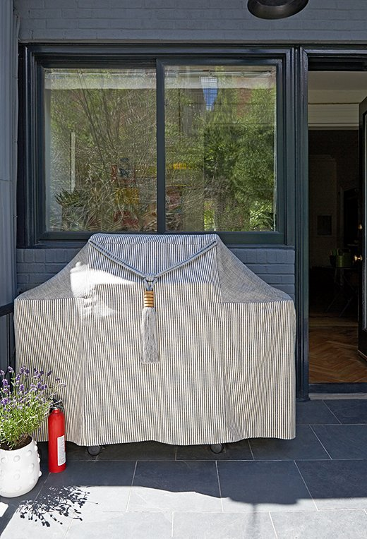 For Day, it's truly personal touches that matter when it comes to warming up spaces reserved for family. We love that she went the extra mile with a custom grill cover to stylishly round out the narrow space.