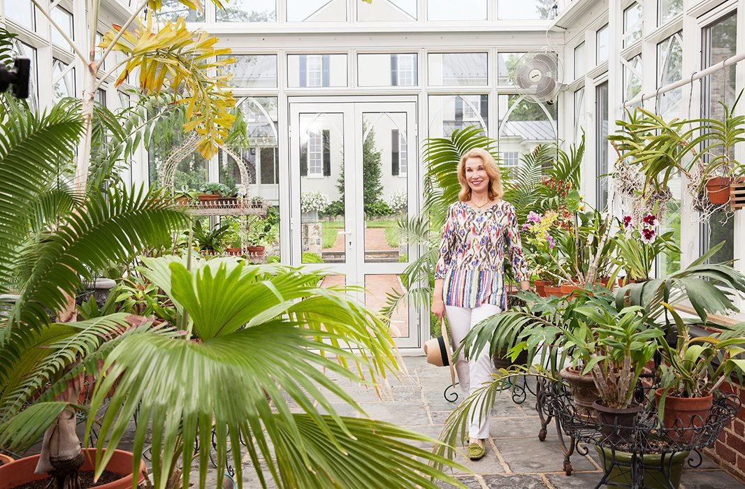 """Elizabeth loves downtime in the greenhouse—although, she says, """"just like everything else in life, you're always tidying up—deadheading flowers, watering the wilting things."""""""