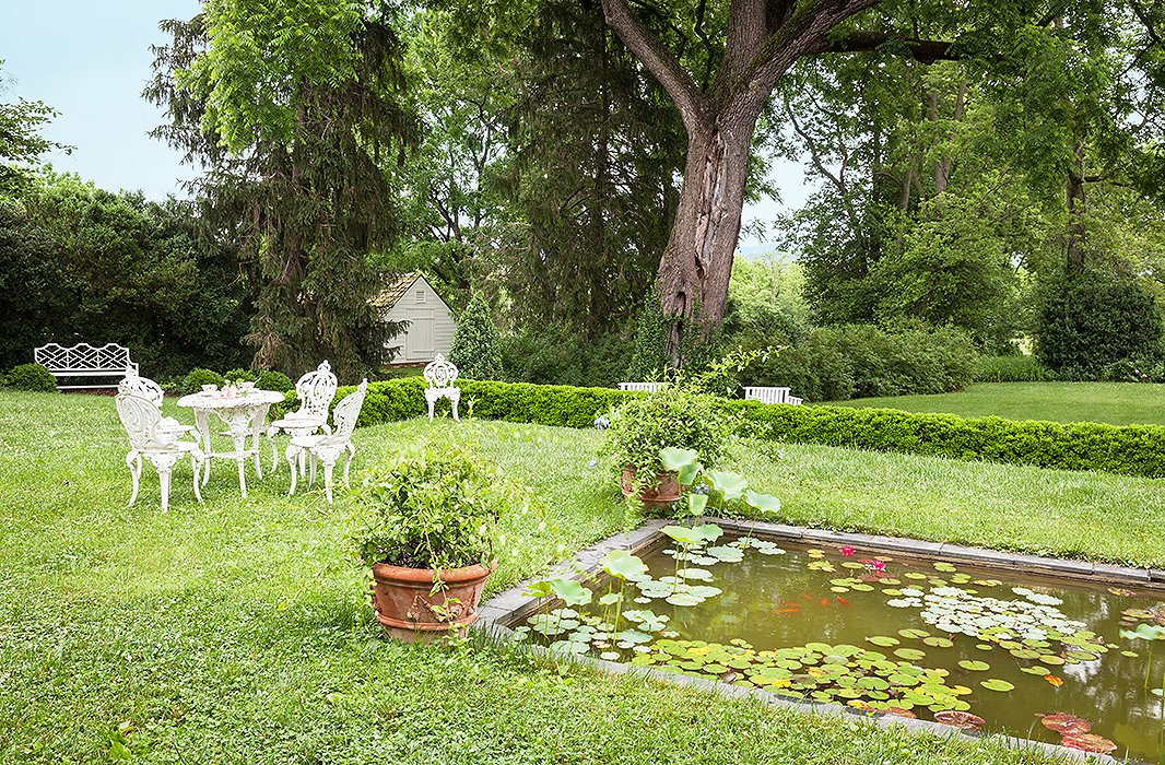 A moment of rural peace is elevated by a lily pool, with elegant seating to take in the views.