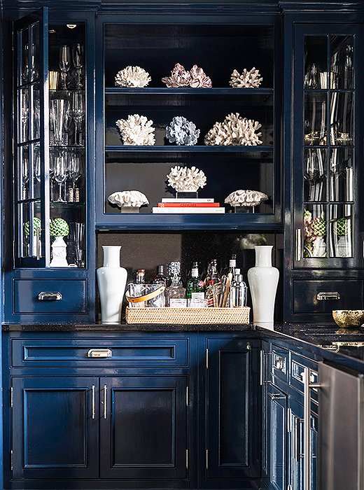 A shade of deep blue on the cabinets of The Zhush founder Sue De Chiara's butler's pantry transforms a pass-through space into a real showstopper. Photo by Lesley Unruh.
