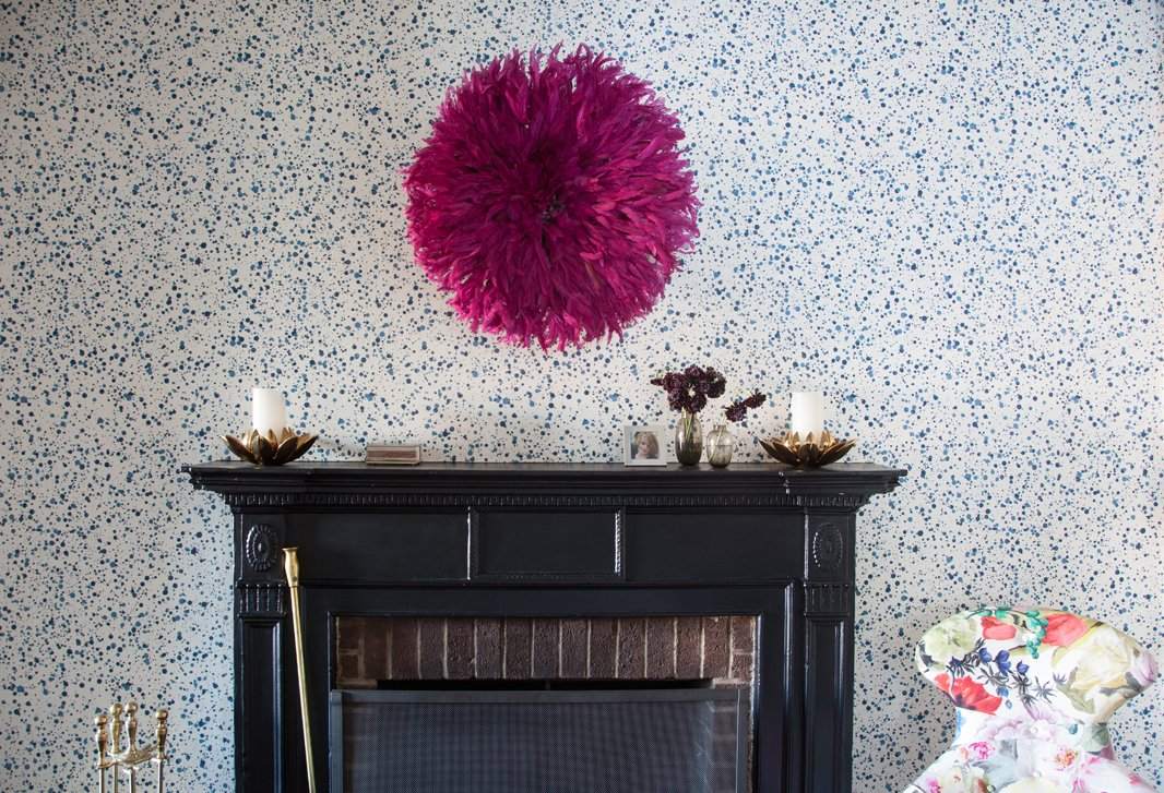 "Lilly, who ""always"" wallpapers hallways, papered the space leading from her living to her dining room with a dotted Hinson design she loves for its handmade look."