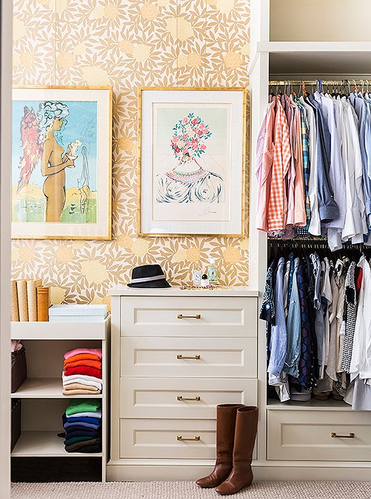 "Nina outfitted the master bedroom closet with an Osborne & Little wallpaper and Dalí prints for a whimsical note. ""It's fairly large for a city closet, but I love that it's so open,"" says Nina of the tailored space she shares with her husband."