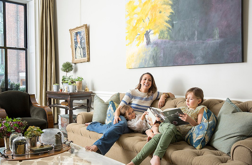 Working from home, Nina gets to spend lots of time with her daughters, eight-year-old Quinn and five-year-old Colette. The painting above the sofa is by Nina's artist mother, Mira Goldberg.