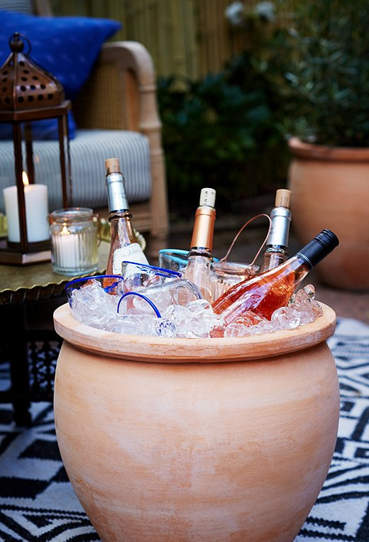 We're big fans of Day's planter-turned-cooler idea for summer entertaining, especially for large get-togethers.