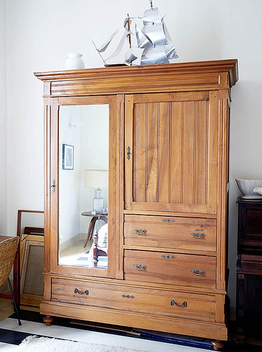 On top of the guest room armoire, Peter perched an aluminum boat that he and his partner found at a junk shop.