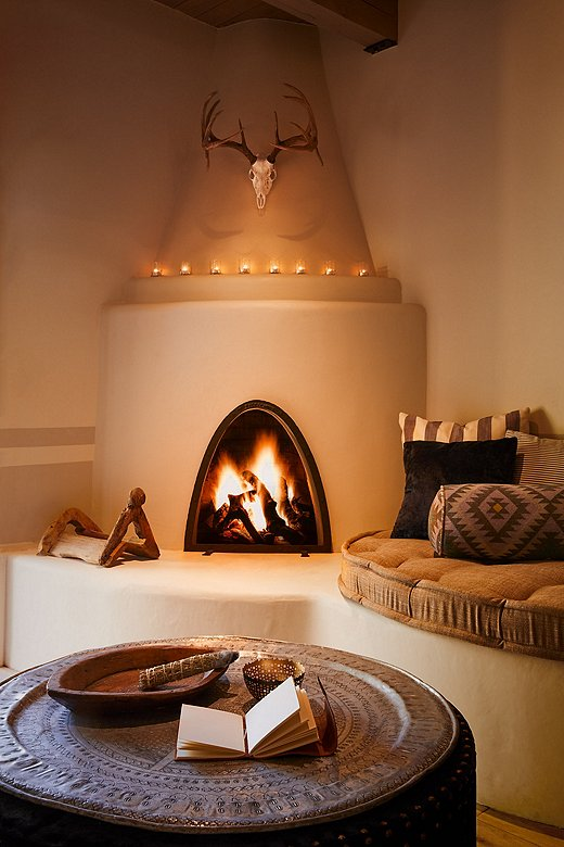 Each of the hotel's 83 guest rooms has its own kiva fireplace, as do the freestanding suites.