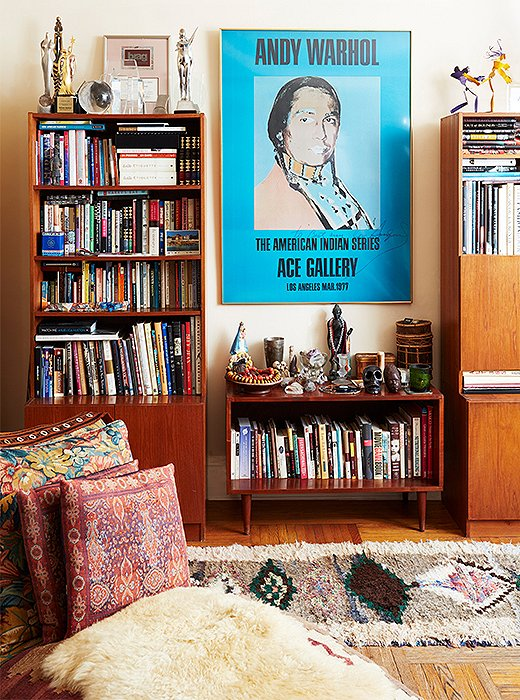 "A poster depicting Russell Means keeps watch over the living room. Shelves are packed with many books she admits to never reading, but Some of Me, written by close friend Isabella Rossellini, is a continual source of inspiration. ""You read it and you feel like you're talking with a friend,"" Hardison says."