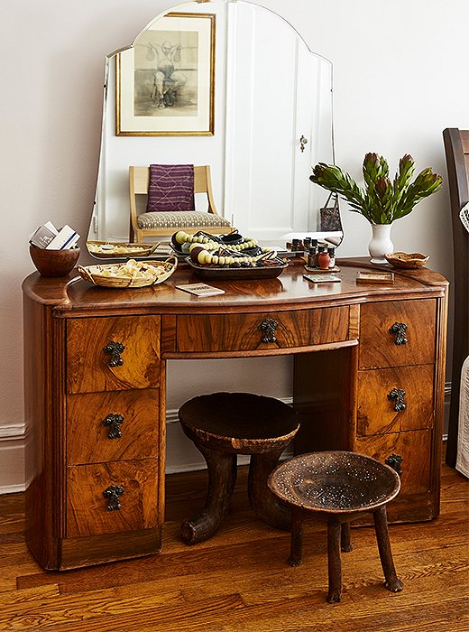A vintage vanity plays host to more of Hardison's jewelry, left on display but organized by way of baskets and bowls.