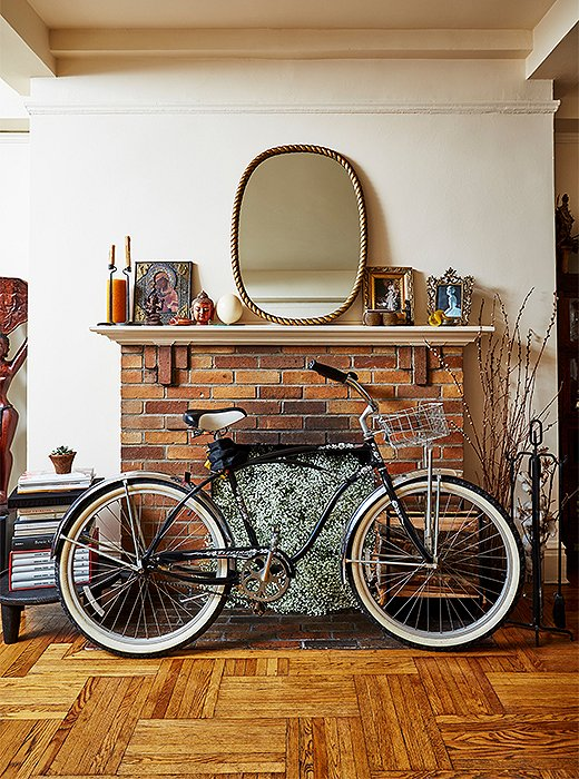 Left on view, Hardison's bike takes on a sculptural quality in front of the fireplace.