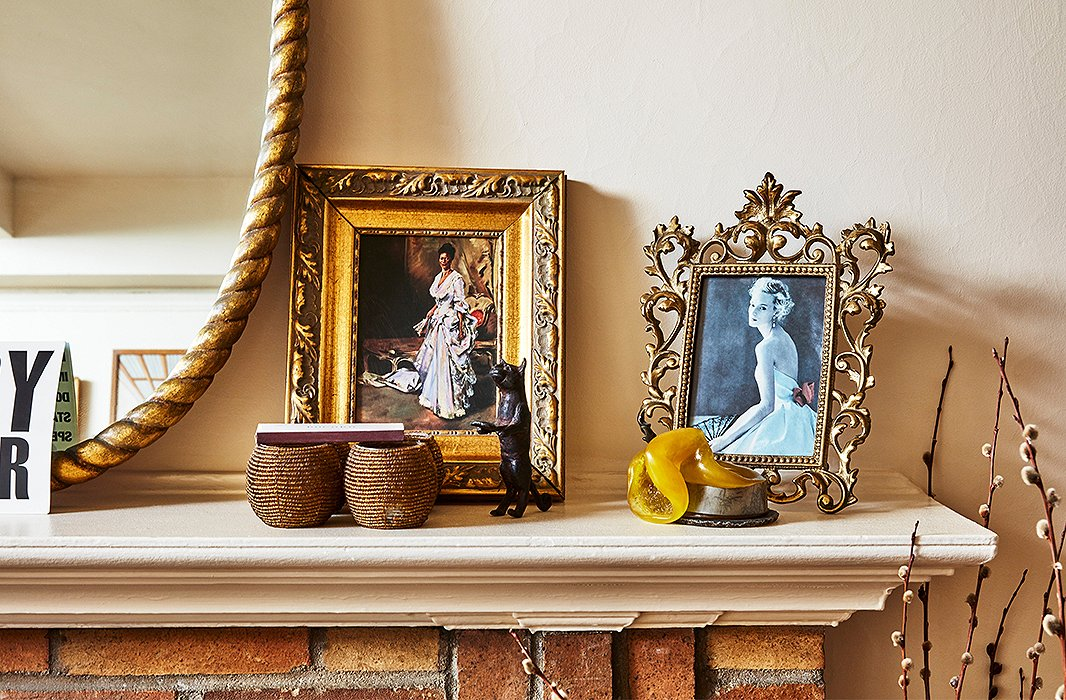 Photographs and mementos hold court on the mantel.