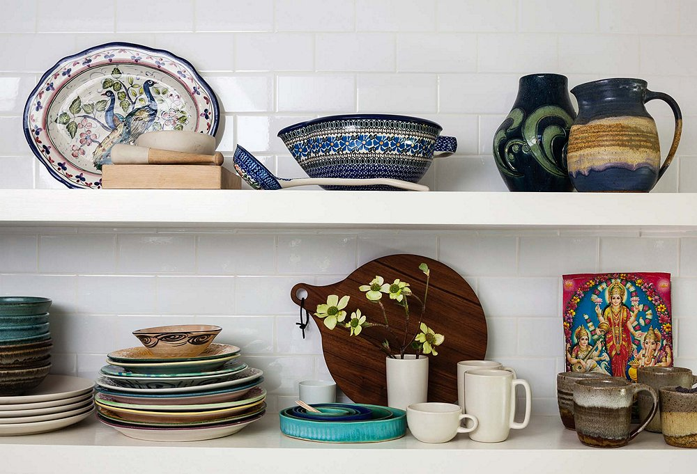 """I love how it can be both decorative and functional,"" says Shiva of her open shelving, which spotlights a serveware collection that includes vintage sake vessels and mugs from Big Sur, a favorite getaway spot. ""It also saves time,"" she adds. ""You don't have to open cabinets and dig around to get something—everything is right there at your fingertips."""