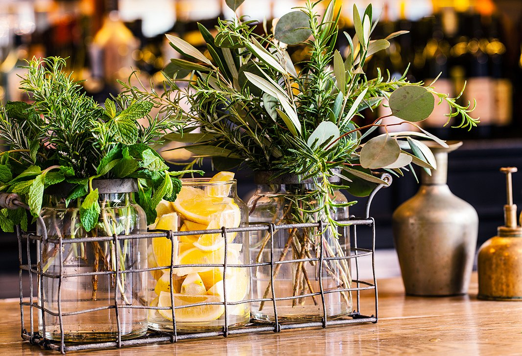 A bright display of herbs and lemons on the A.O.C. bar.