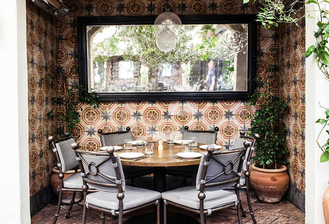 Portuguese tile makes a patio dining nook feel like a Mediterranean oasis.