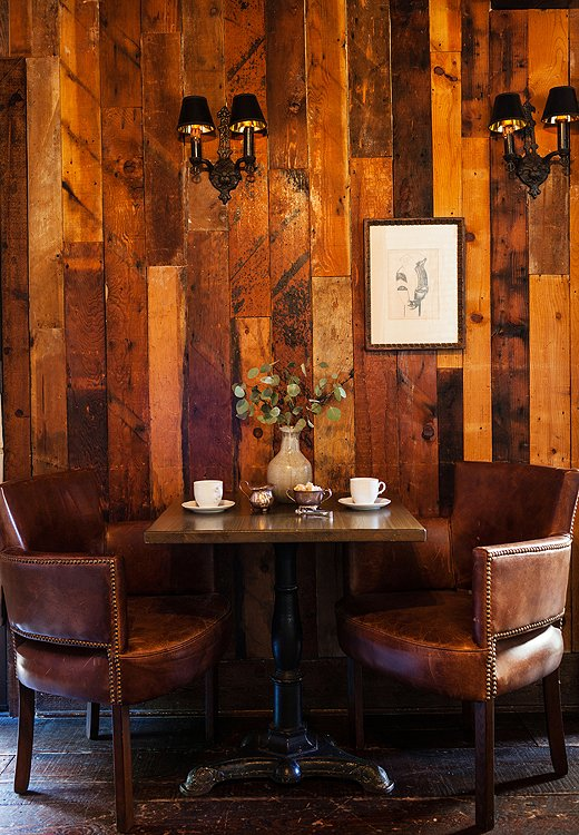 A section of the private dining room upstairs. Here, Claire kept the original wood paneling and modified the lighting.