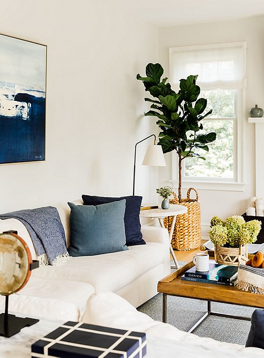 Chauncey went with layered neutrals and touches of blue in the familyroom. Woven jute elements throughout the room punch up the texture and modern vibe.