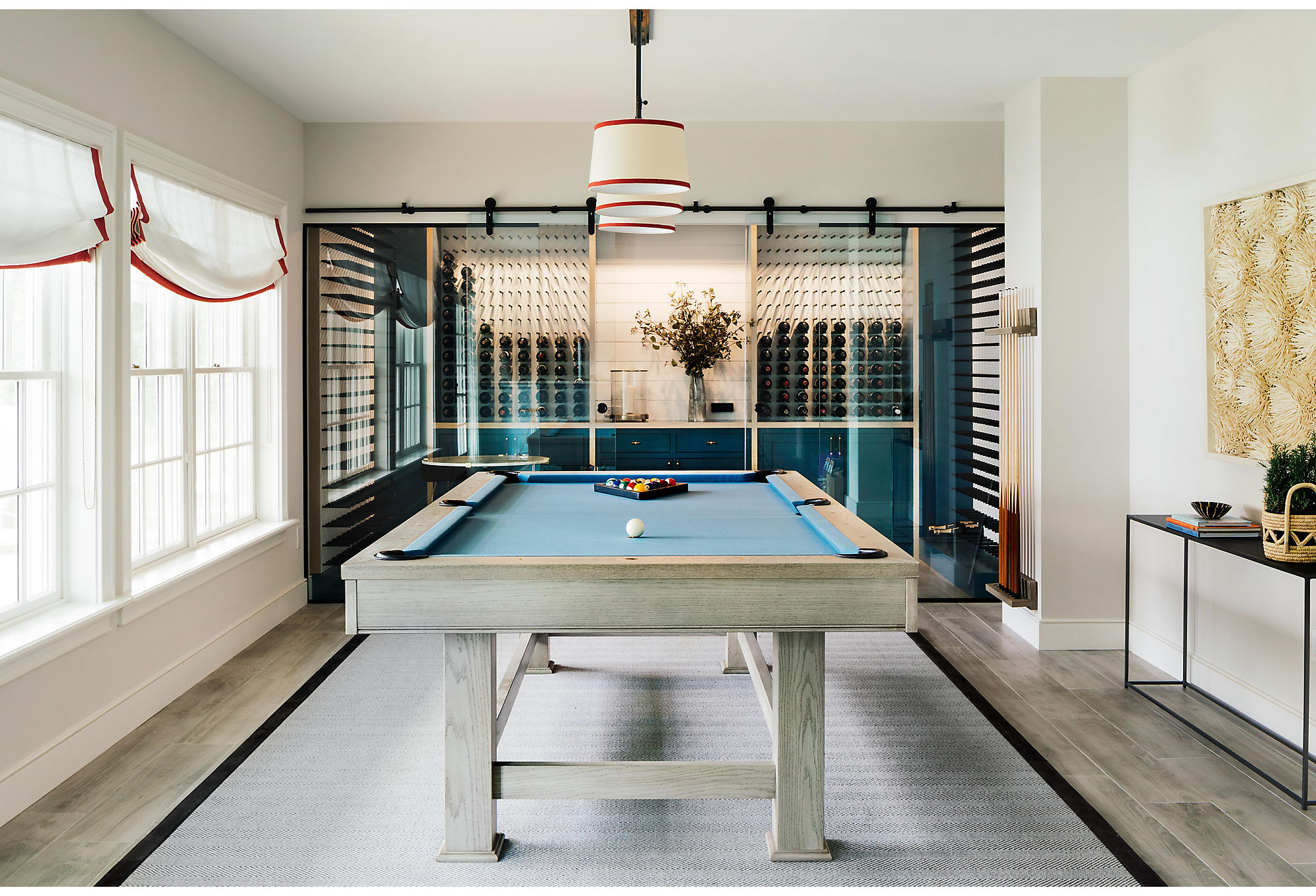 """Don't be fooled into thinking the redesigned basement is just a glorified man cave, warns Chauncey. """"It was really the wifewho was the driving force of this space,"""" she says. """"I don't know what you would tag the 'she shed' version of a wine cellar, but this is it."""""""