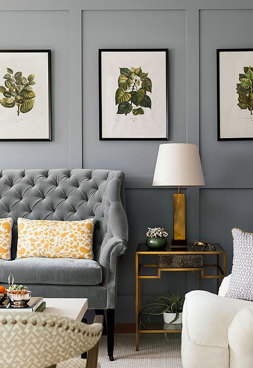 "The choice to go dark in the formal living room was actually client-led. ""I usually have to do a lot of arm-twisting when it comes to strong colors,"" says Chauncey. She chose to lighten the space up with whites, marigolds, and greens."