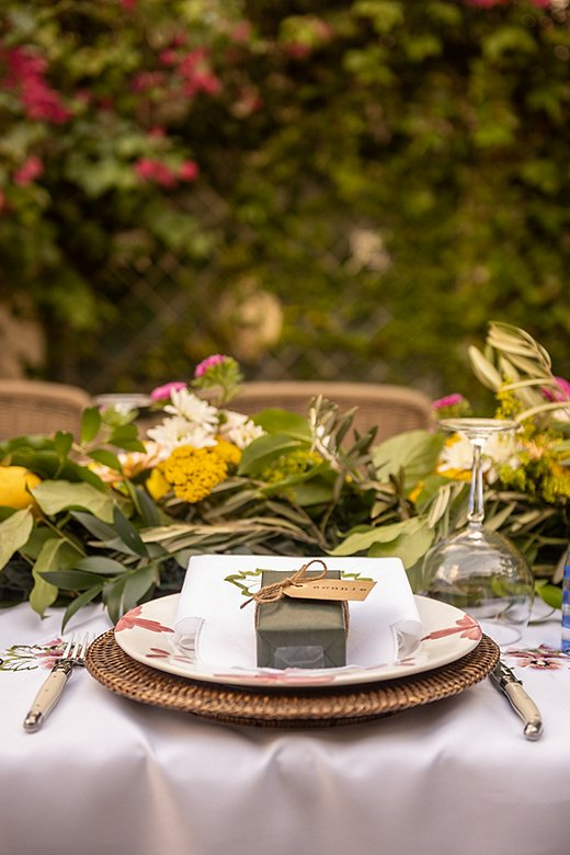 Use extra floral clippings to line your table as Miami designer Constanza Collarte has done here. Photo by Chris Carter.