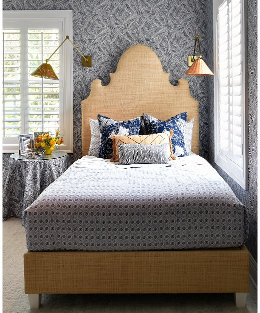 Caroline turned this small guest room in to a jewel-box space by going bold with the wallpaper and textures.