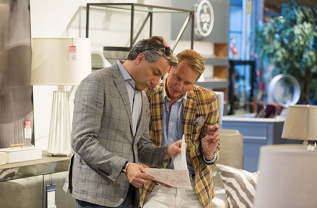 Thom Filicia and Carson Kressley. Above: A room designed by Thom and Carson features a round dining table, cleverly placed books, and artwork from Lillian August.