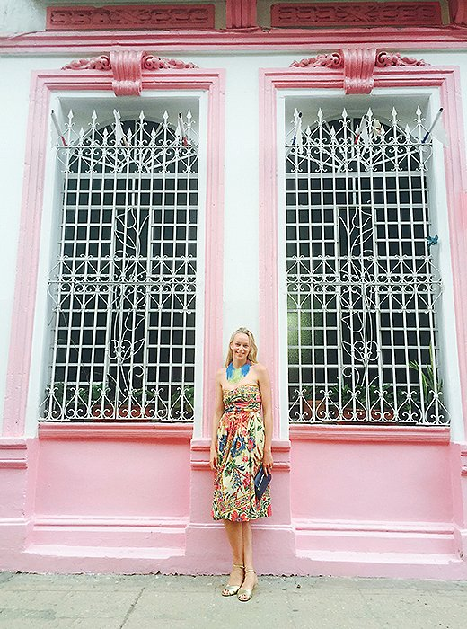 Me, trying to blend into the local scenery. After days spent exploring Havana in practical walking shoes and big sun hats, it was refreshing to shower and dress up for dinner. Photo by Laetitia Stanfield (and necklace by her, too!)