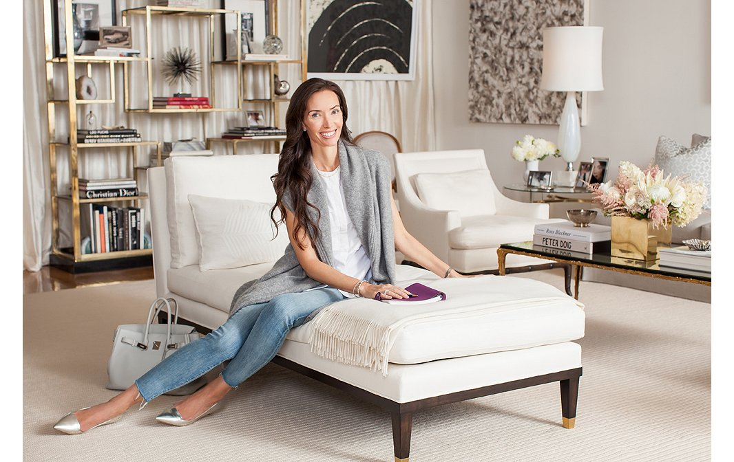 The custom-made oversize chaise is layered with a white cashmere throw. Underfoot, the white wool rug, custom-ordered from Peru, looks like a thick woven sweater with wide loops.