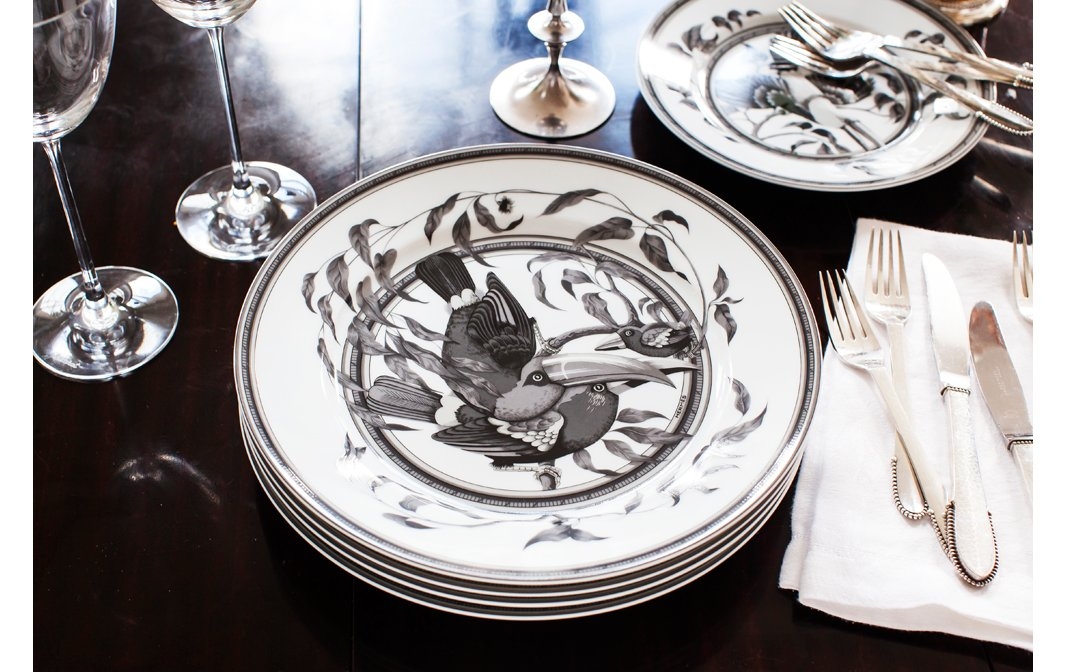 For fancier evenings, Chantecaille pulls out her set of Hermès china. The shades of gray complement the loft's tones perfectly—and let the food shine.