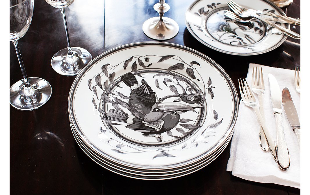 For fancier evenings, Chantecaillepulls out her set of Hermès china. The shades of gray complement the loft's tones perfectly—and let the food shine.
