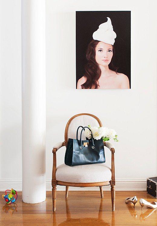 A striking portrait of Olivia by New York painter Will Cotton, a close friend, energizes an otherwise simply decorated portion of the hallway.