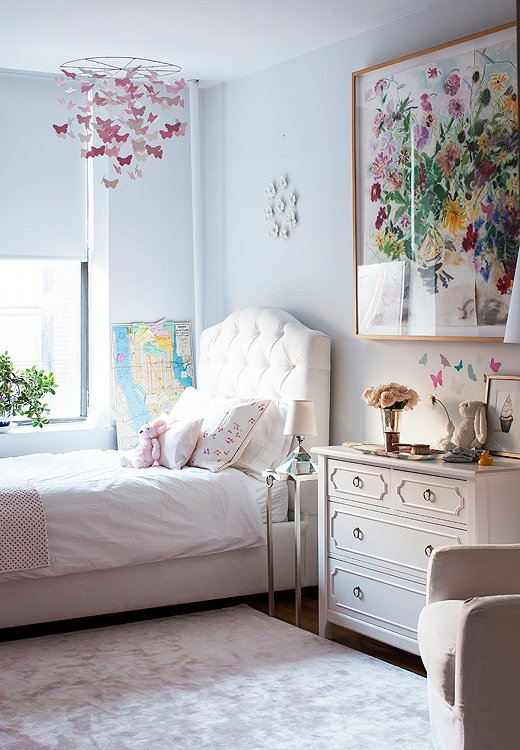 Delphina's bedroom is unabashedly feminine, but it's worth noting that the same palette of grays and whites used in the living room extends to the nursery.